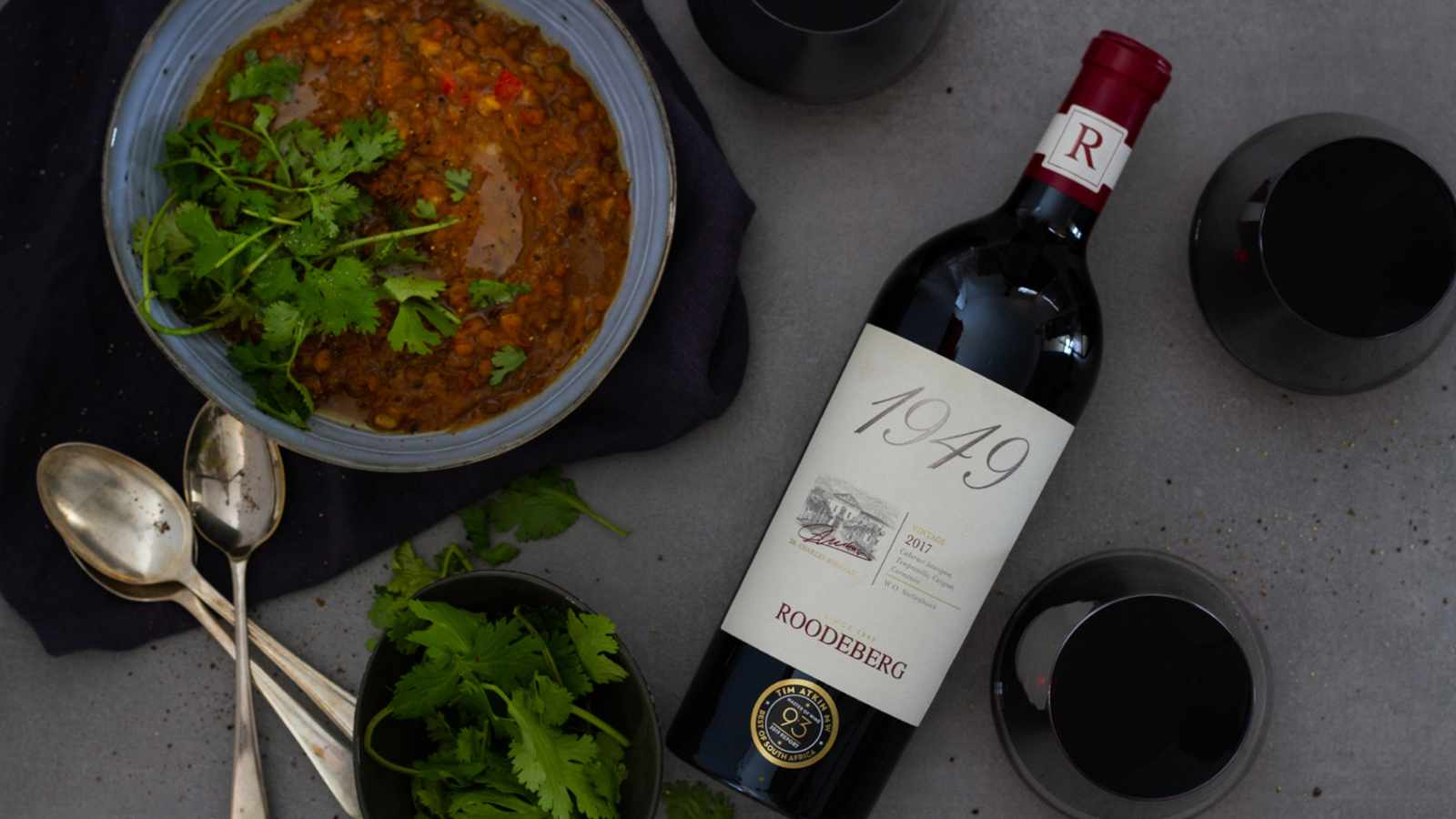 A hearty lentil and lamb soup paired with a full-bodied red wine