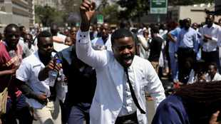 Zimbabwe seeks to slow exodus of doctors as economy collapses