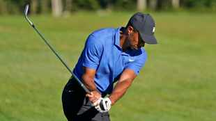 Tiger Woods lurks four shots off the pace after improved putting display in playoffs opener