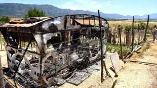 Murder suspect's trailer torched after he's caught red-handed dragging woman's body