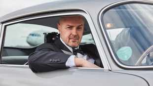 Paddy McGuinness slips into 007 mode behind the wheel of an Aston Martin on 'Top Gear'
