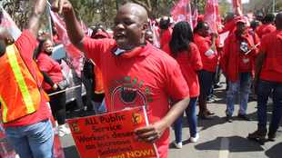 Nehawu members picket outside Cyril Ramaphosa offices for better pay, working conditions