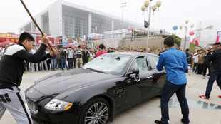 Owner smashes his Maserati in protest