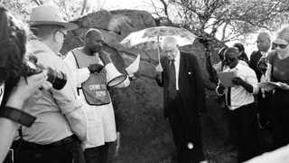 011012. Wonderkop Informal Settlement in Marikana near Rustenburg, North West. Honourable Judge Ian Gordon Farlam with his panel listens to the police crime expert during the inspection of the scene where Lonmin mineworkers were killed by police in Marikana, the commission at the scene they are from the public hearing of the Marikana Commission of Enquiry to investigate the Marikana tragedy at which 44 people were killed and scores injured. Picture: Dumisani Sibeko