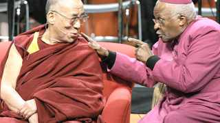 """040914: The Dalai Lama, left, listens during a lighthearted moment with Archbishop Desmond Tutu, of South Africa, at a panel discussion addressing the topic of inspiring spiritual compassion in youth Tuesday, April 15, 2008 at the University of Washington in Seattle. he event took place on the final day of a five-day visit by the Dalai Lama to Seattle centered around the theme of """"Seeds of Compassion."""" (AP Photo/Ted S. Warren)"""