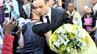 11/04/2014 Oscar Pistorius recieves flowers from an emotional supporter outside the Pretoria High court after the court adjournment. Picture: Phill Magakoe