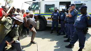 12/09/2012 Police keep a close eye on Striking Anglo Platinum mineworkers during their protest march yesterday demanding a basic pay of R14 500.  Picture: Phill Magakoe