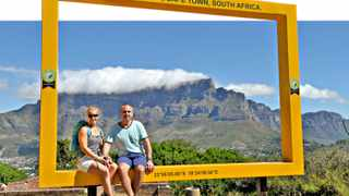 131217. Cape Town. British tourist Geoff and Kathryn Cox on holiday in Cape Town posing for a picture at the newly erected N7W frame on Signal Hill. Table Mountain Cableway and Table Mountain National Park will unveil the 2nd in a series of Table Mountain New7Wonders frames tomorrow⬠this time on Signal Hill. The frame provides a striking vantage point of Table Mountain and is sure to draw interest from local and international visitors to Signal Hill. The first N7W frame was launched on World Tourism Day in September in the V&A Waterfront. The frames are an official World Design Capital 2014 project. Picture Henk Kruger/Cape Argus