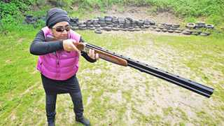 140827. Cape Town. Shahnaaz Slamang with her Maroochi 12 gauge shotgun and her Glock on her hip interviewed at the False Bay Shooting club. Shanaaz is doing Clay pigeon shooting, also known as clay target shooting, this is the art of shooting a firearm at special flying targets, known as clay pigeons or clay targets. Picture Henk Kruger/Cape Argus. Reporter Chelsea Geach