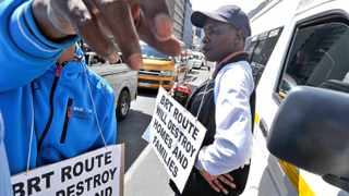 141120. Cape Town. Wynberg residents and taxi associations joined forces and gathered in front of parliament protesting against the City of Cape Town's MyCiti planned routes through Wynberg. Approx 50 taxi's blocked Roeland street with angry residents blaming the city for not consulting with them. Picture Henk Kruger/Cape Argus