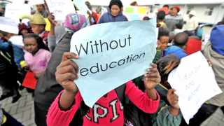 150720. Cape Town, Children are seen picketing at a school in DuNoon. DuNoon residents who have occupied a vacant mobile school in the area in a bid to ensure an education for hundreds of unplaced children say they are going nowhere. Picture Henk Kruger/Cape Argus. Reporter Ilse Fredericks