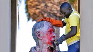 160217. Cape Town. Contract workers are cleaning statues and memorials that were damaged with red spray paint. Police used stun grenades to disperse protesting students at the University of Cape Town (UCT) last night. Demonstrators went on the rampage, torching and stoning one Jammie Shuttle bus and a UCT bakkie.Picture Henk Kruger/Cape Argus