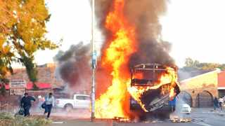 21/06/2016. A bus and a truck torched in Atteridgeville as angry community members protested against the nomination of Thoko Didiza as the City of Tshwane's mayoral candidate. Hundreds of people have either been left stranded or prevented from leaving the township. Picture: Oupa Mokoena