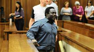 25/11/2013 Chanelle Henning murder accused Andre Gouws and his co-accused Ambrose Monye at the Pretoria High Court moments after being found guilty of murder. Picture: Phill Magakoe