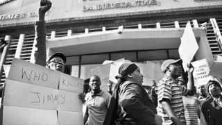 306 16.08.2012 Suppoters of former speaker of the Mbombela municipality Jimmy Mohlala, protest outside the Nelspruit Magistrate Court. Mohlala was gunned down last year outside his home after he exposed corruption related to construction of Mbombela World Cup stadium. Picture: Itumeleng English