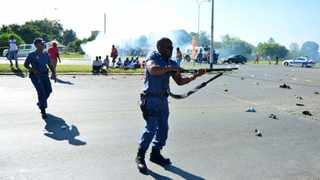 657-Members of the SAPS shoot rubber bullets towards the marching crowd over service delivery at Randfontein. 04.02.2015 Picture:Dumisani Dube