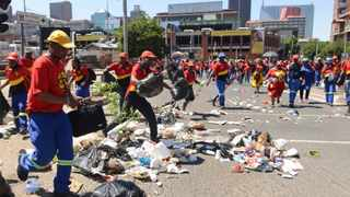964 South African Municipal Workers Union who work for Pikitup marched on the streets of Johannesburg and Braamfontein trashing the streets with rubbish. 241115 Picture: Boxer Ngwenya