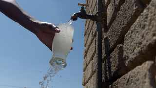 A Hammanskraal resident pours water from a tap. Picture: Oupa Mokoena/African News Agency (ANA)