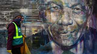 A Man walks past a mural of Nelson Mandela. The world celebrates Mandela Day on Saturday as part of an annual international day in honour of Nelson Mandela. Picture: Brendan Magaar/African News Agency(ANA)