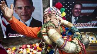 A Peruvian shaman makes a ritual of predictions for the 2012 US election, at San Cristobal hill in Lima.
