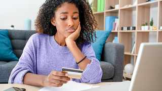 A South African woman thinks twice about spending money after considering her financial health.