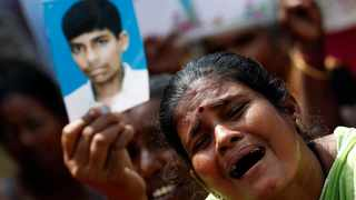 A Tamil woman cries as she hold up an image of her disappeared family member during the war against Liberation Tigers of Tamil Eelam (LTTE). File picture: Dinuka Liyanawatte/Reuters