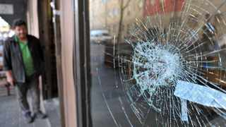 A WINDOW is damaged after looting and protesting in Maboneng, in Johannesburg. Picture: Timothy Bernard African News Agency (ANA)