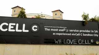 """A banner, which earlier displayed a customer's anger at service provider Cell C in Beyers Naude Drive in Johannesburg, now reads """"The most useful service provider in SA - Cell C Sandton City"""". The bottom of the banner which originally gave the name of the franchise manager and his phone number, claiming he had said that his �unnamed executive head refuses to assist the customer� now read �We love Cell C�. Picture: Werner Beukes/SAPA"""