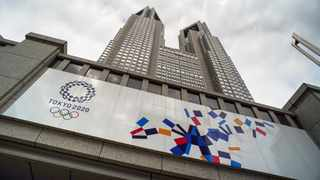 A board of Tokyo 2020 Olympics Games is displayed on the wall of the Tokyo Metropolitan Government building. Photo: Kazuhiro Nogi/AFP