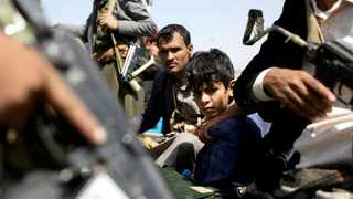 A boy rides with Houthi followers on the back of a patrol truck during the funeral of Houthi fighters killed during battles against government forces, in Sana'a, Yemen. File picture: Khaled Abdullah/Reuters
