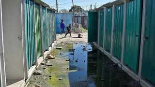 A boy walks past rows of flush toilets in the RR Section of Khayelitsha. Picture: Jason Boud