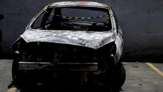 A burned car in which a body was found during searches for the Greek Ambassador for Brazil Kyriakos Amiridis, is pictured at a police station in Belford Roxo on December 30, 2016. File picture: Ricardo Moraes/Reuters