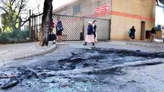 A car was burnt next to Saxonwold Post Office in Rosebank near Johannesburg. The car was quickly removed and only the dark spot of ash and broken glass remains 020914 Picture: Boxer Ngwenya