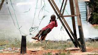 A child plays on a makeshift swing in Eldorado Park, west of Joburg, where drug and substance abuse have ravaged the community. Picture: Werner Beukes / SAPA.