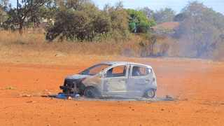 A community in Limpopo allegedly assaulting a man and later burned him to death in his vehicle after they accused him of stealing alcohol. Picture: Supplied