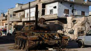 A destroyed Syrian army tank which was attacked during clashes between the Syrian government forces and the Syrian rebels.