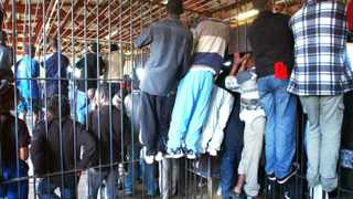 A file picture of  juvenile awaiting-trial prisoners hanging on the bars of holding cells at Pollsmoor Prison in Tokai. Picture: Brenton Geach