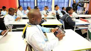 A grade 12 pupil at Protea high school uses a tablet as Gauteng classrooms go digital. Soweto. Pic: Itumeleng English