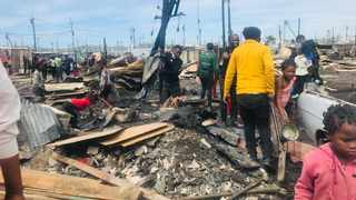 A group of about 300 residents who were living in a TRA in Wallacedene were left destitute on Monday afternoon, when a fire ravaged through their community, destroying in its wake at least 85 shacks. Picture: Nomalanga Tshuma