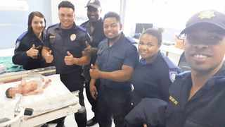 A group of officers assisted a homeless woman who went into labour near the Mitchells Plain Community Health Centre. Picture: Supplied