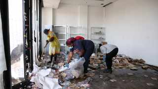 A group of young people clean up at Bridge city in Kwamashu after the unrest. Picture: Motshwari Mofokeng African News Agency (ANA)