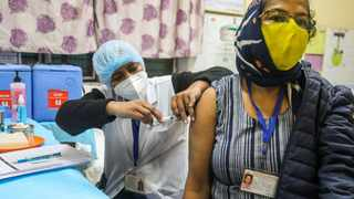 A health worker wearing a face mask holds a syringe with a dummy vaccine to a volunteer during a nationwide dry run for Covid-19 vaccine at the health care center at South Delhi Municipal Corporation Darya Ganj. Picture: Naveen Sharma / SOPA Images/Sipa USA