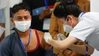 A healthcare worker receives a Bharat Biotech's Covid-19 vaccine called COVAXIN, during the coronavirus disease vaccination campaign at All India Institute of Medical Sciences (AIIMS) hospital in New Delhi. Picture: Adnan Abidi/Reuters
