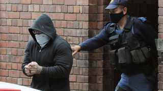 A heavily guarded Zane Killian appeared in the Cape Town's Magistrate's court yesterday, charged as a co-conspirator in the attempt on the life of prominent criminal attorney William Booth. Pictures: Tracey Adams/African News Agency(ANA)