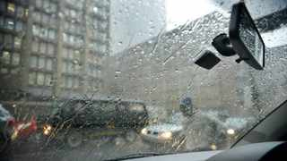 A heavy downpour of rain and hail saw Johannesburg traffic coming to a standstill, people running for cover and others just running in the rain. Heavy rain comes down, how drivers in cars will see the rain. Picture: Karen Sandison