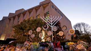 A menorah is installed outside the Tree of Life Synagogue in preparation for a celebration service at sundown on the first night of Hanukkah in December 2018 in the Squirrel Hill neighbourhood of Pittsburgh. Picture: Gene J. Puskar/AP