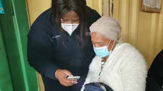 A pensioner receives assistance from a provincial health department official with the EVDS registration. Picture supplied.