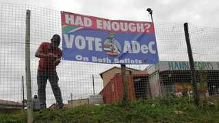 A person hooking up an ADeC poster to a fence in Phoenix, north of Durban. Picture: Visvin Reddy/Facebook