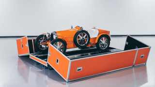 A personalised hand-built carrying case allows for safe transport of the car