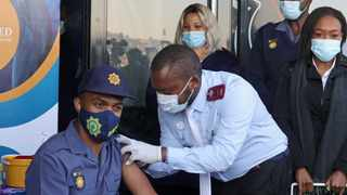 A police officer gets his vaccine at the Orlando stadium in Soweto. Picture: Timothy Bernard/African News Agency(ANA)